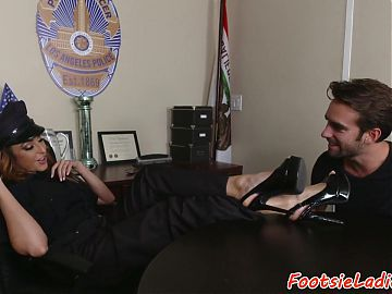 Babe footworshiped in police outfit